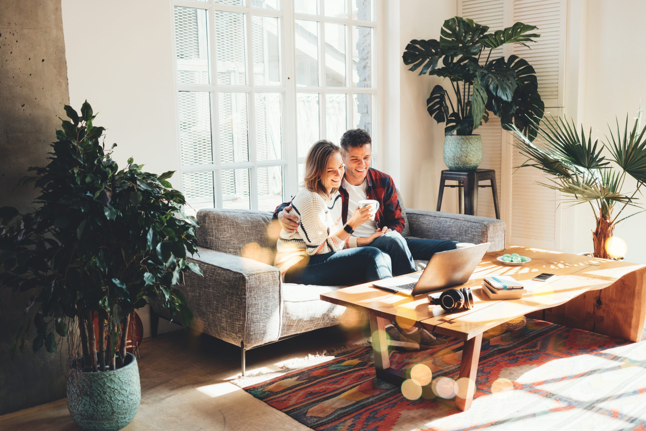 couple on couch in front of window