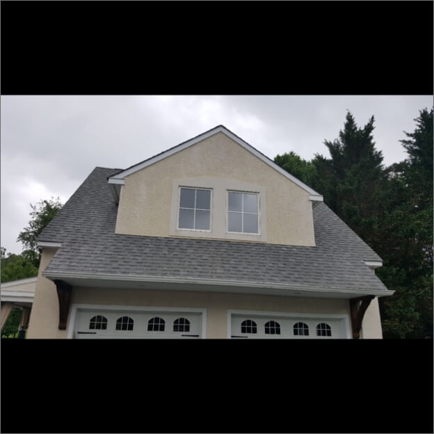 The same roof with clean shingles