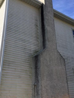Side of house slathered in filth