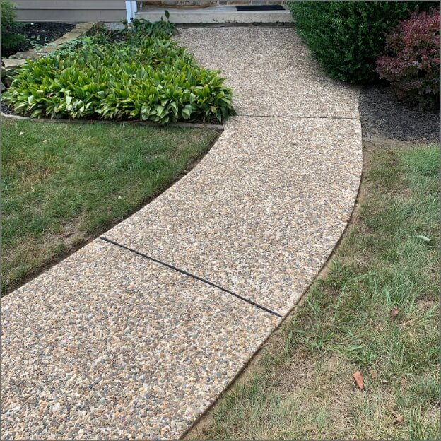 Same sidewalk but now cream-colored and vibrant