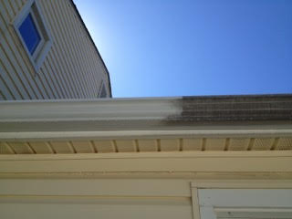 The same gutter as before, but partially cleaned revealing a a clean creamy white glean