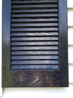 A shiny brown gutter after power-washing