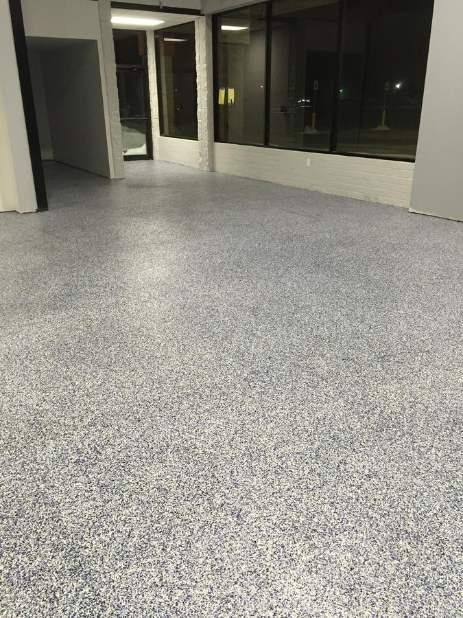 A room with a finished concrete floor.