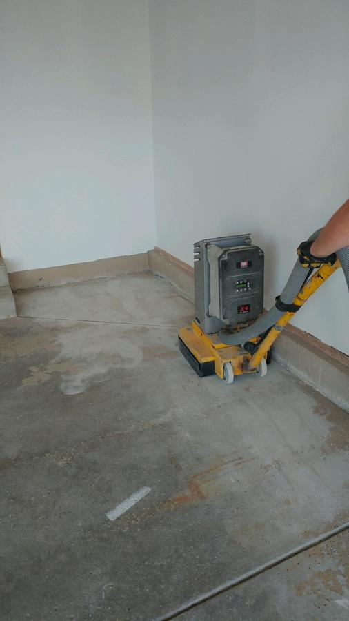 A concrete floor in the process of being finished.