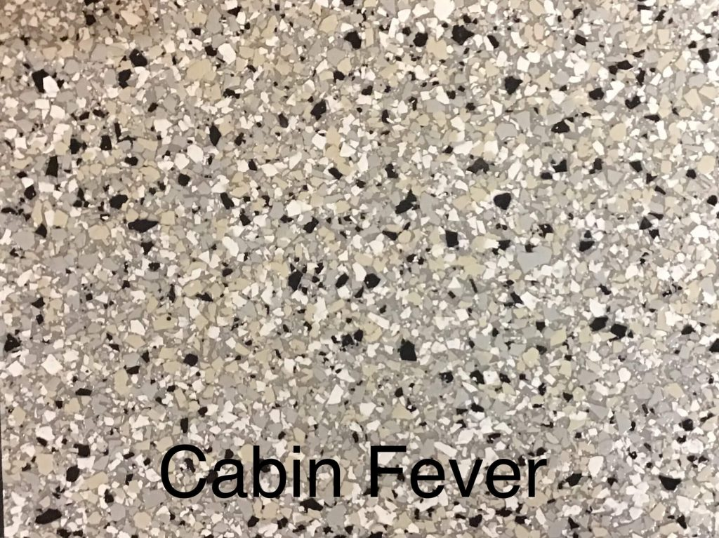 A floor color called cabin fever, with light cream, gray, and black specks