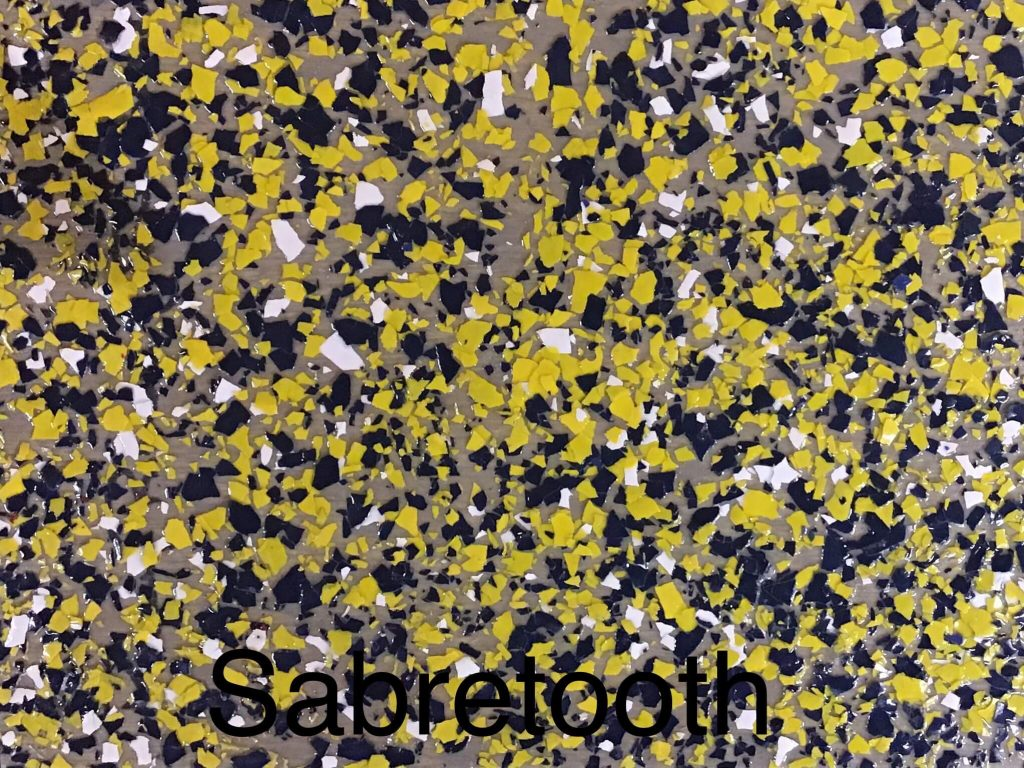 A floor color called sabretooth with mostly yellow specks, mixed with black and white specks.