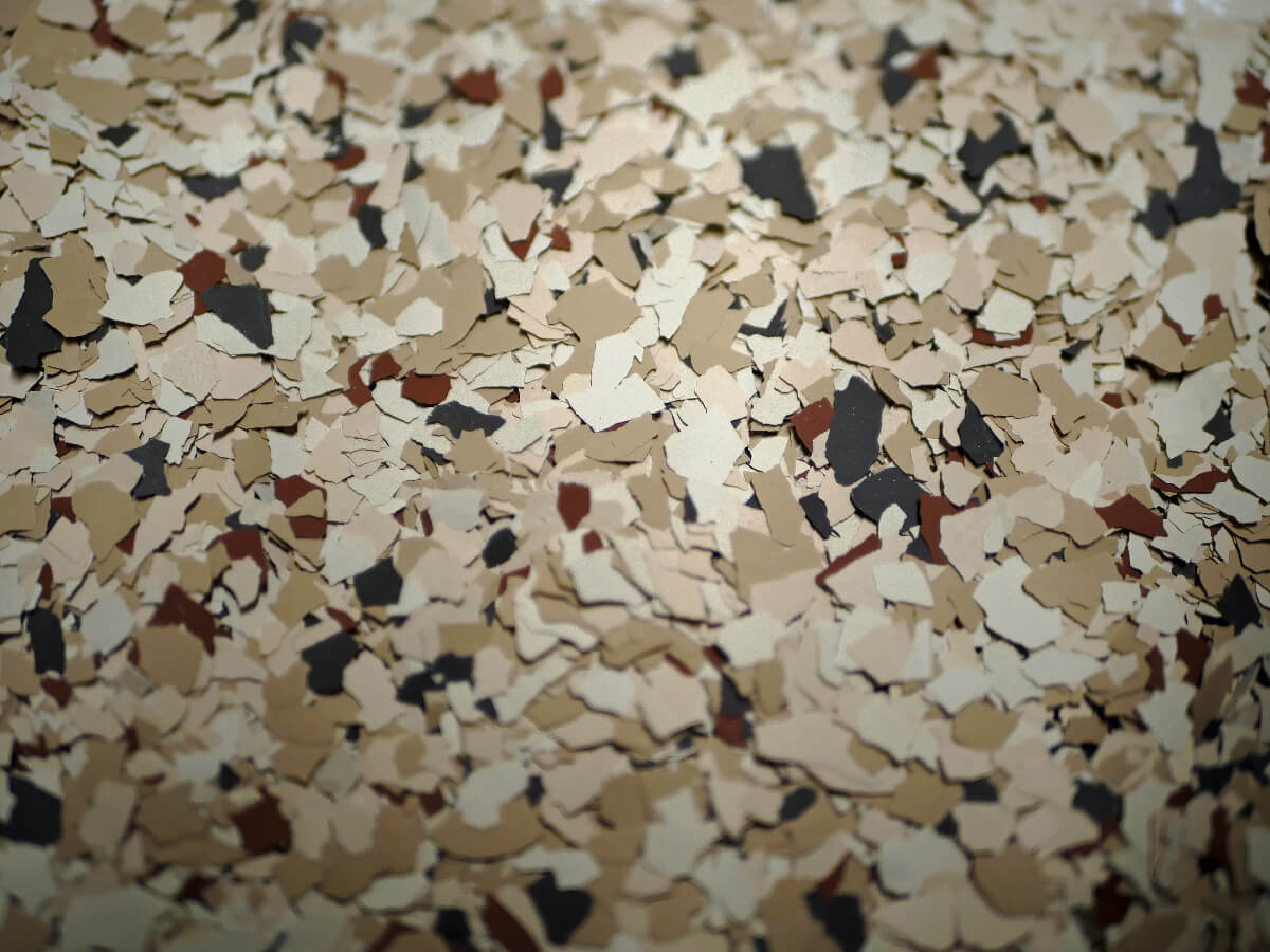 a floor with speckled variants of brown and tan