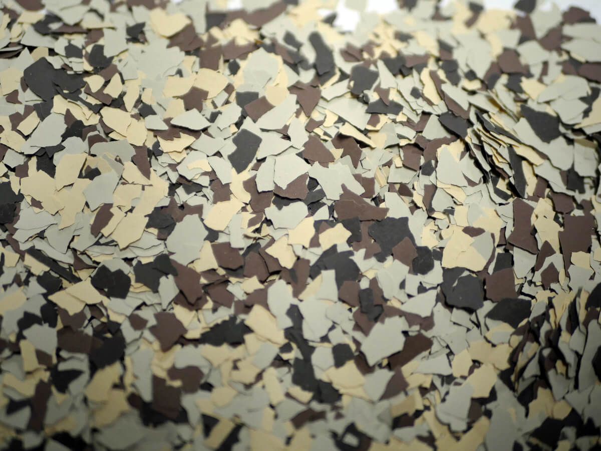 a floor with speckles of dark brown, white and light tan
