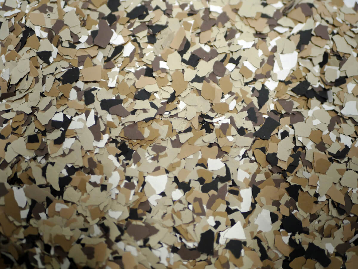a floor with speckles of white with golden browns