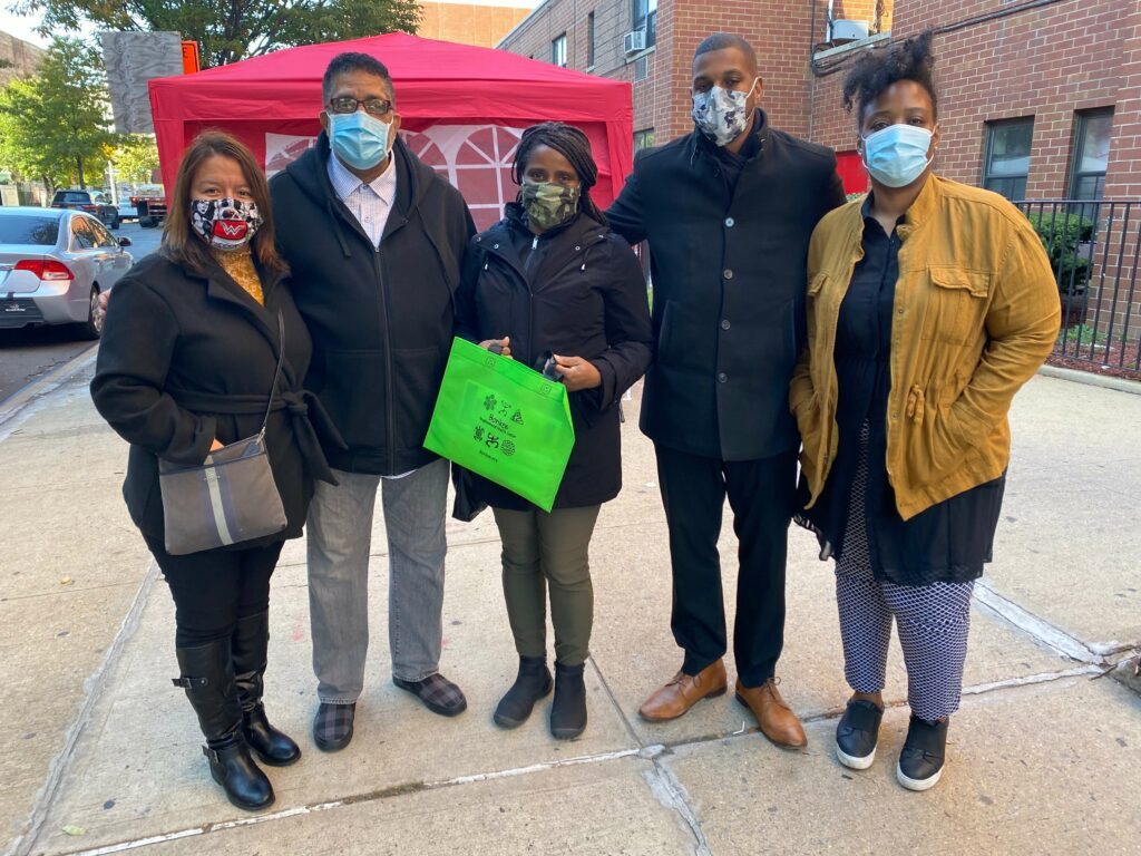 People poing together at outdoor flu clinic