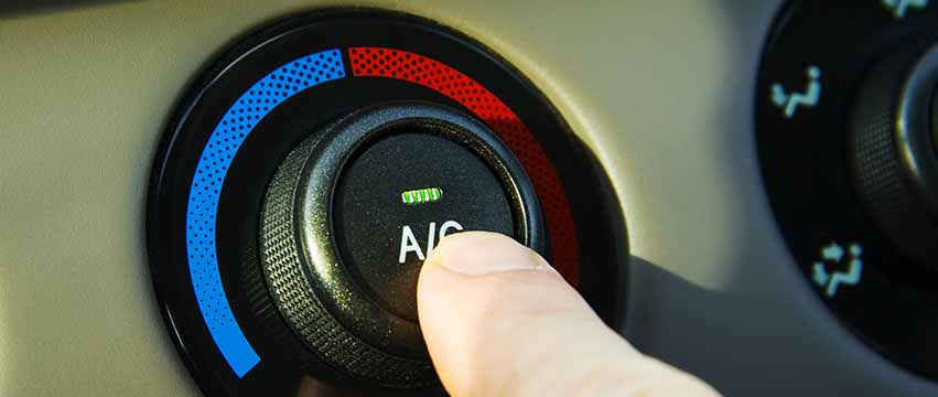 a finger pushing an Air Conditioning button
