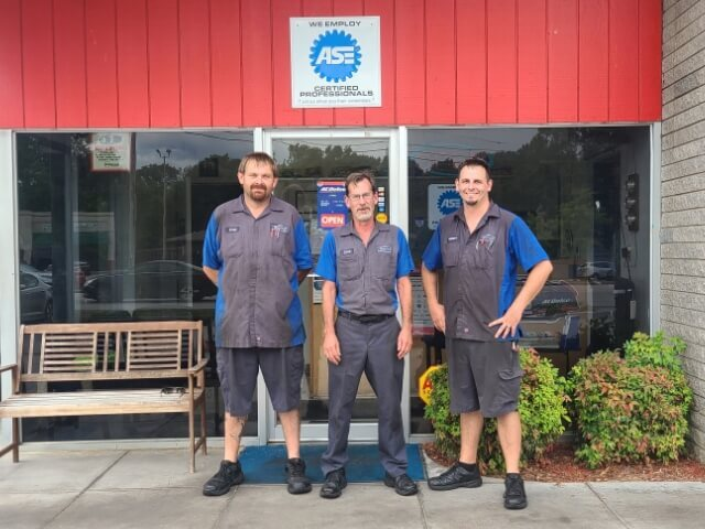 Three Boyer employees outside the store with welcoming arms