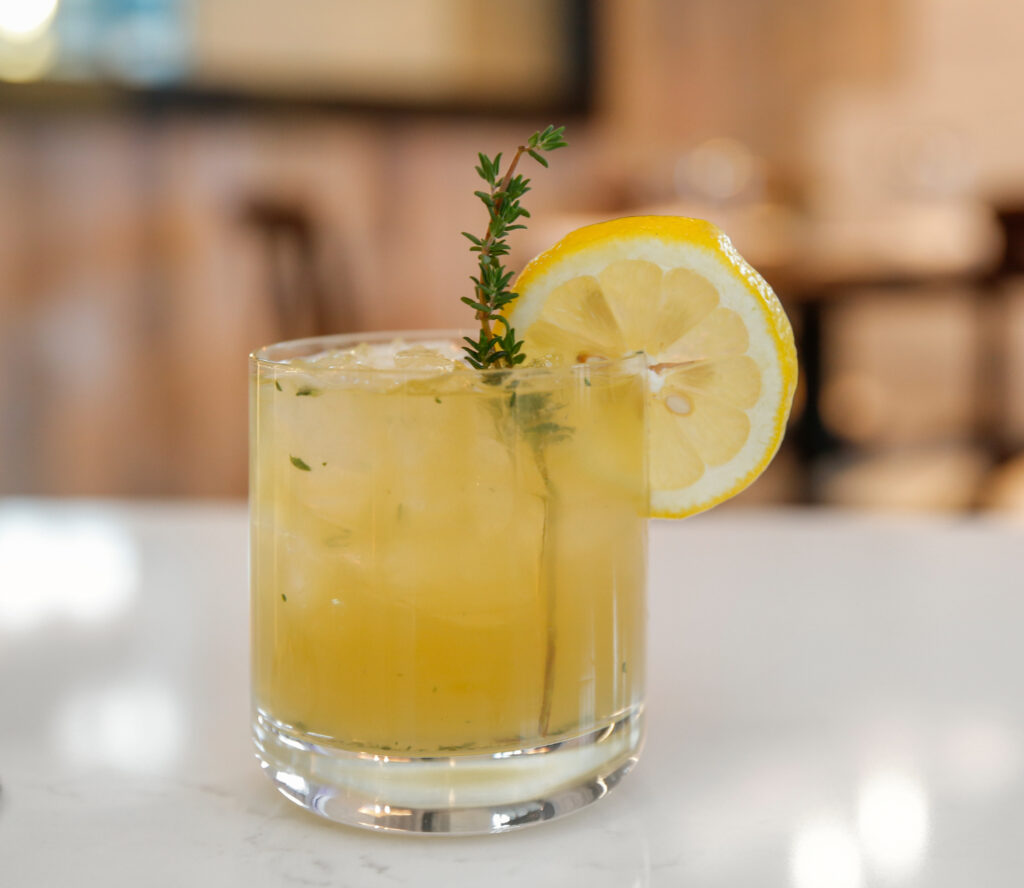 a cool, refreshing cocktail garnished with a lemon slice