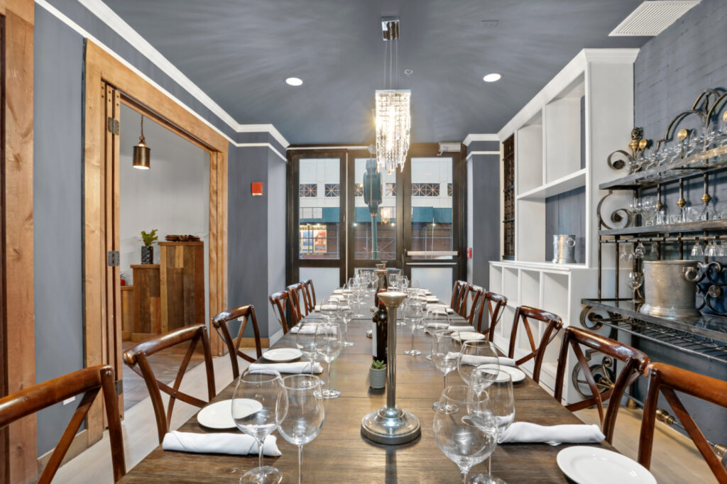 an overview of a long table in the dining area at Divina Restaurant