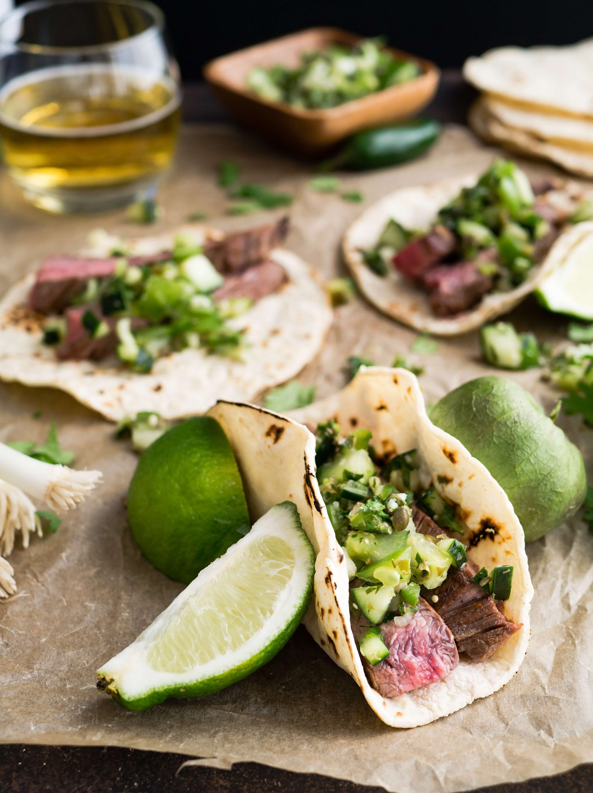 tacos being made, surrounded by lime slices