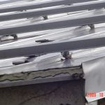 Metal rails on the roof of a house.