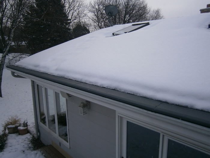 The roof of a house with gutter protection covers over the gutter.