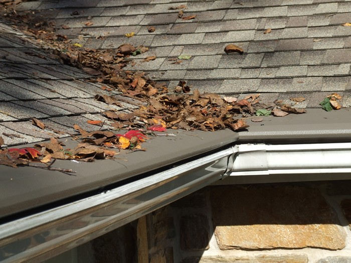 A roof with the gutter protection cover.