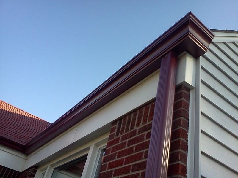 Profile gutters after installation, colored to fit the color-scheme of the house.