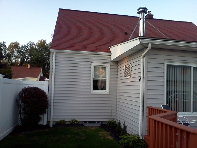 The side of a house before profile gutters are installed.