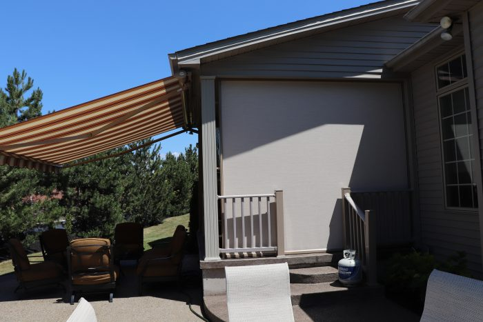 A retractable awning in context on the side of a house.