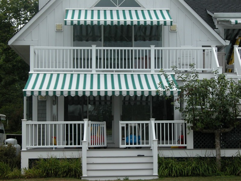 Retractable awnings in context, covering a deck.