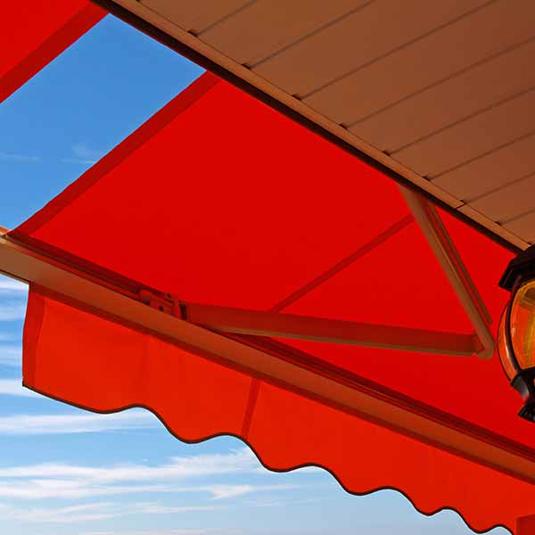 A red-orange awning overlooking the sky.