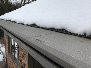 a roof in winter with Helmet Heat from Gutter Helmet