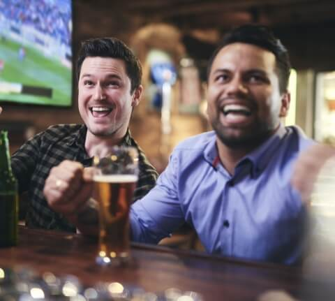 Two happy guys at a bar