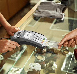 a person paying with a credit card machine