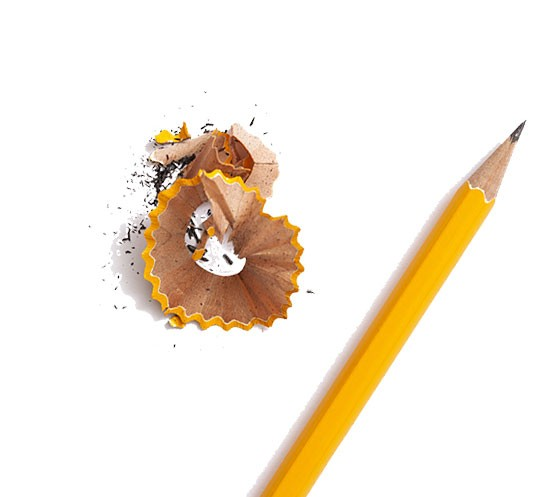 a sharpened pencil with pencil shavings next to it