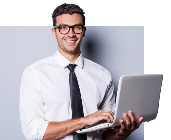 a man in a suit holding a computer