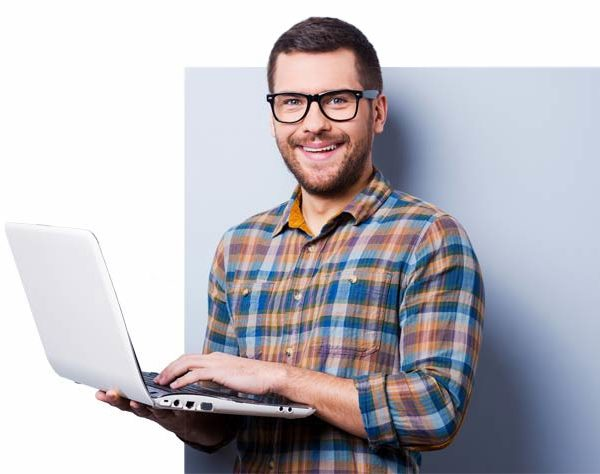 A smiling guy with a laptop