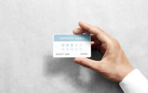 a person holding a loyalty card