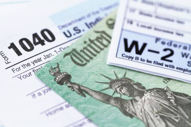 an image of American tax forms, including a 1040 and a w-2.