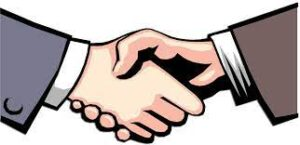 two people in suits shaking hands