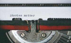 """a typewriter typing """"stories matter"""""""