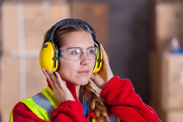 Headphones on a construction worker to avoid hearing loss.