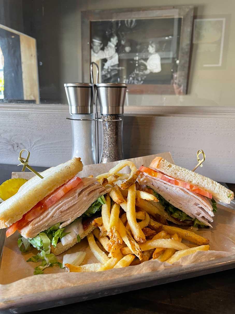 Kix turkey Sandwich and Fries on a Plate