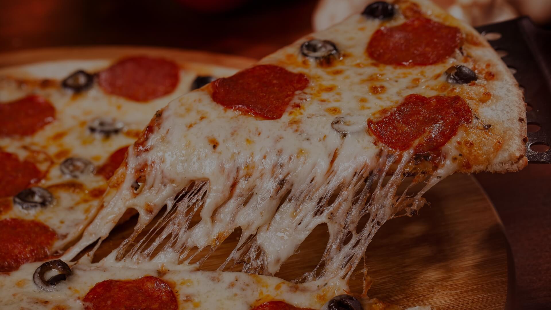 Cheesy slice of pizza