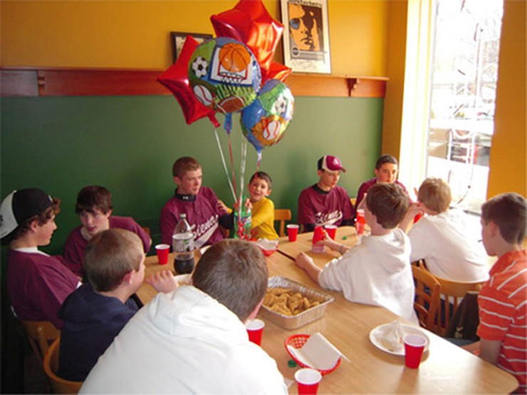 Pizza party for a team of Little League players