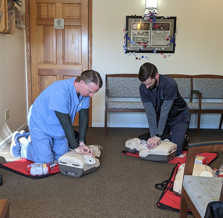 Two people giving CPR