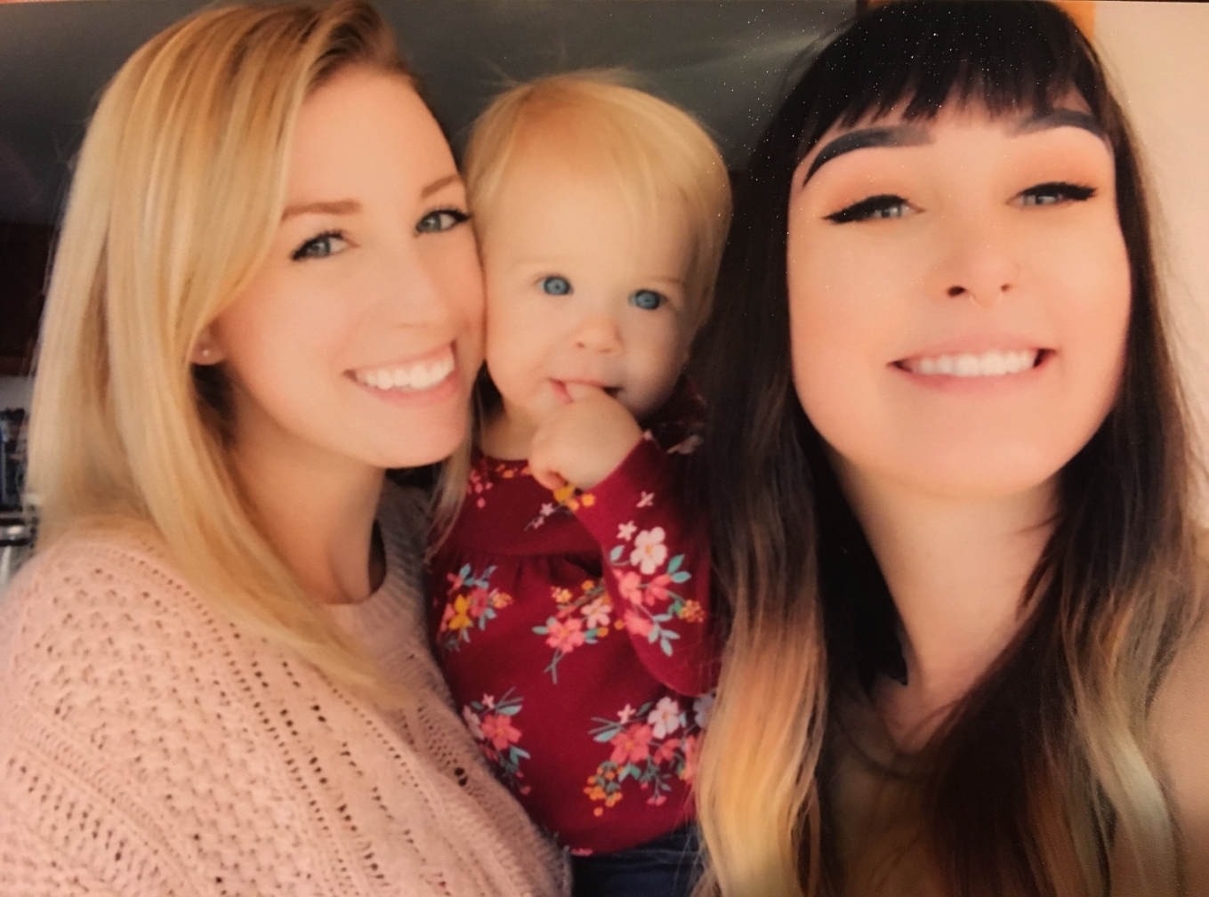 The smiling and beautiful Ashley and Dakota with Ashley's young daughter