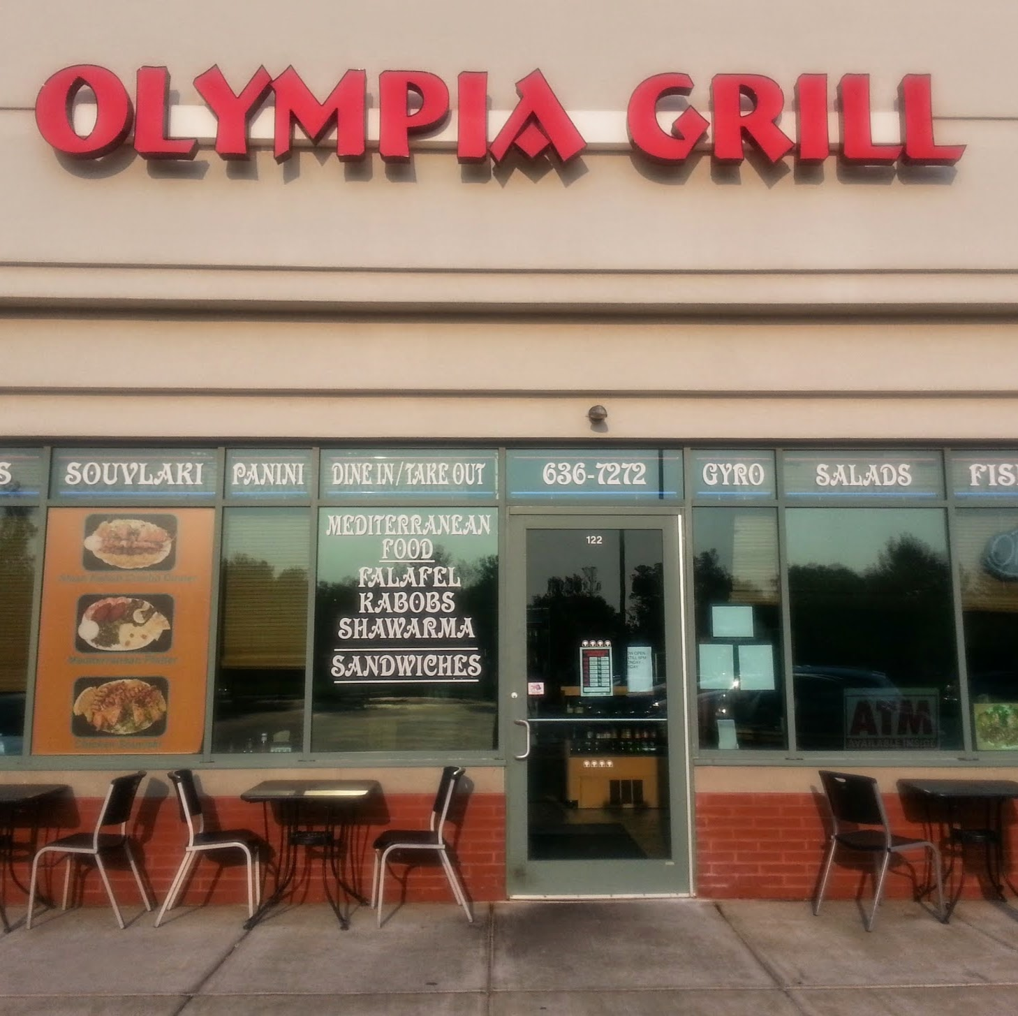The Olympia Grill storefront, complete with our sign and window decals highlighting our Greek and Lebanese specialty dishes.
