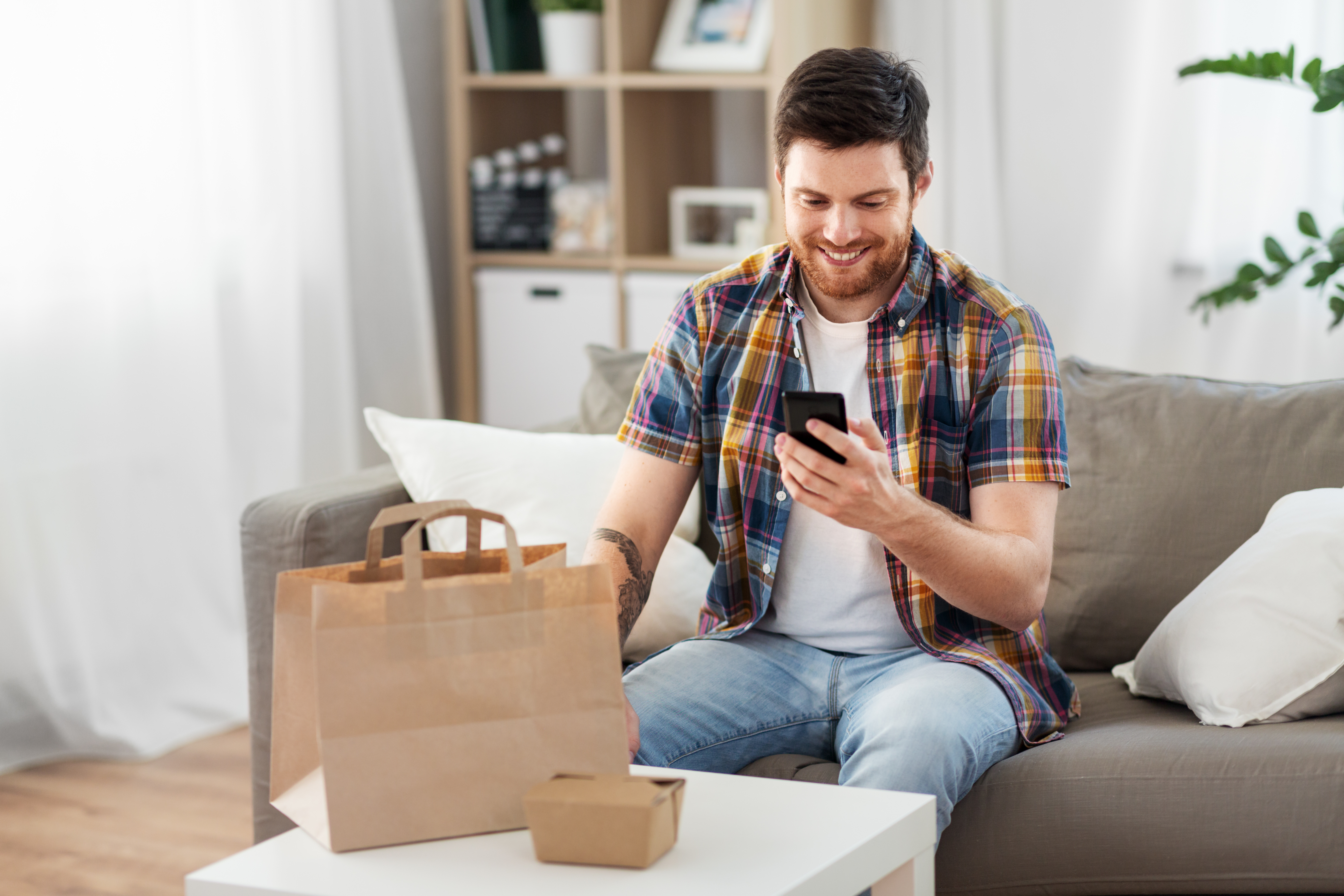 happy guy ordering take out
