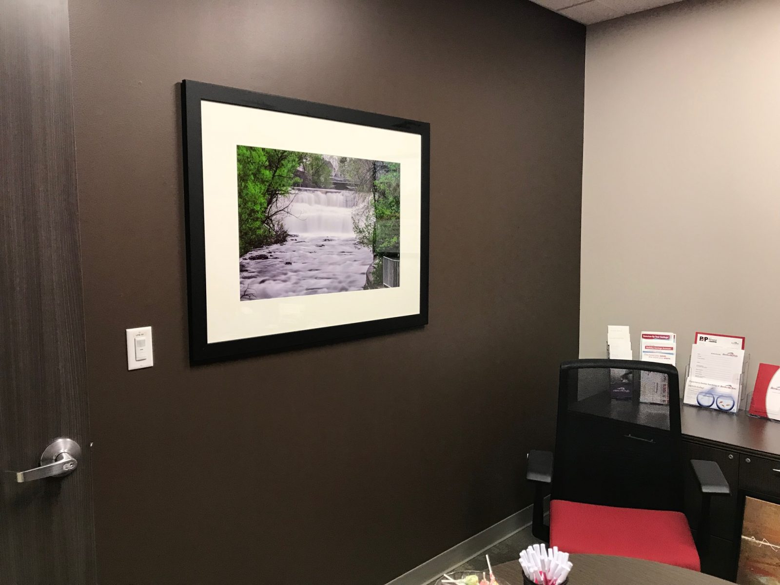 framed photograph above a desk