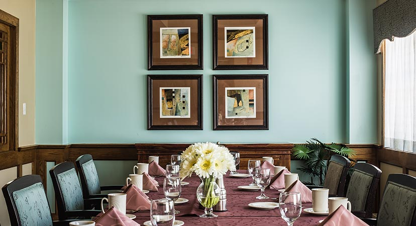 framed pieces of artwork above a dinner table