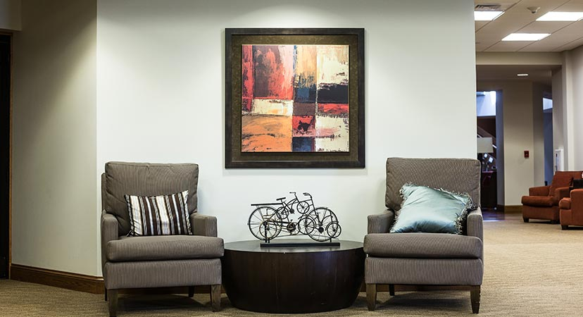 a framed painting in the lobby of a business