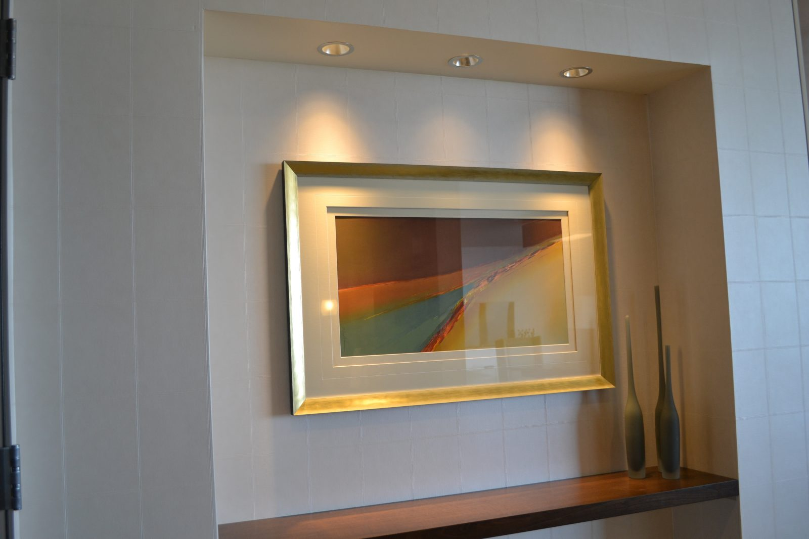 framed artwork on the wall of an office building