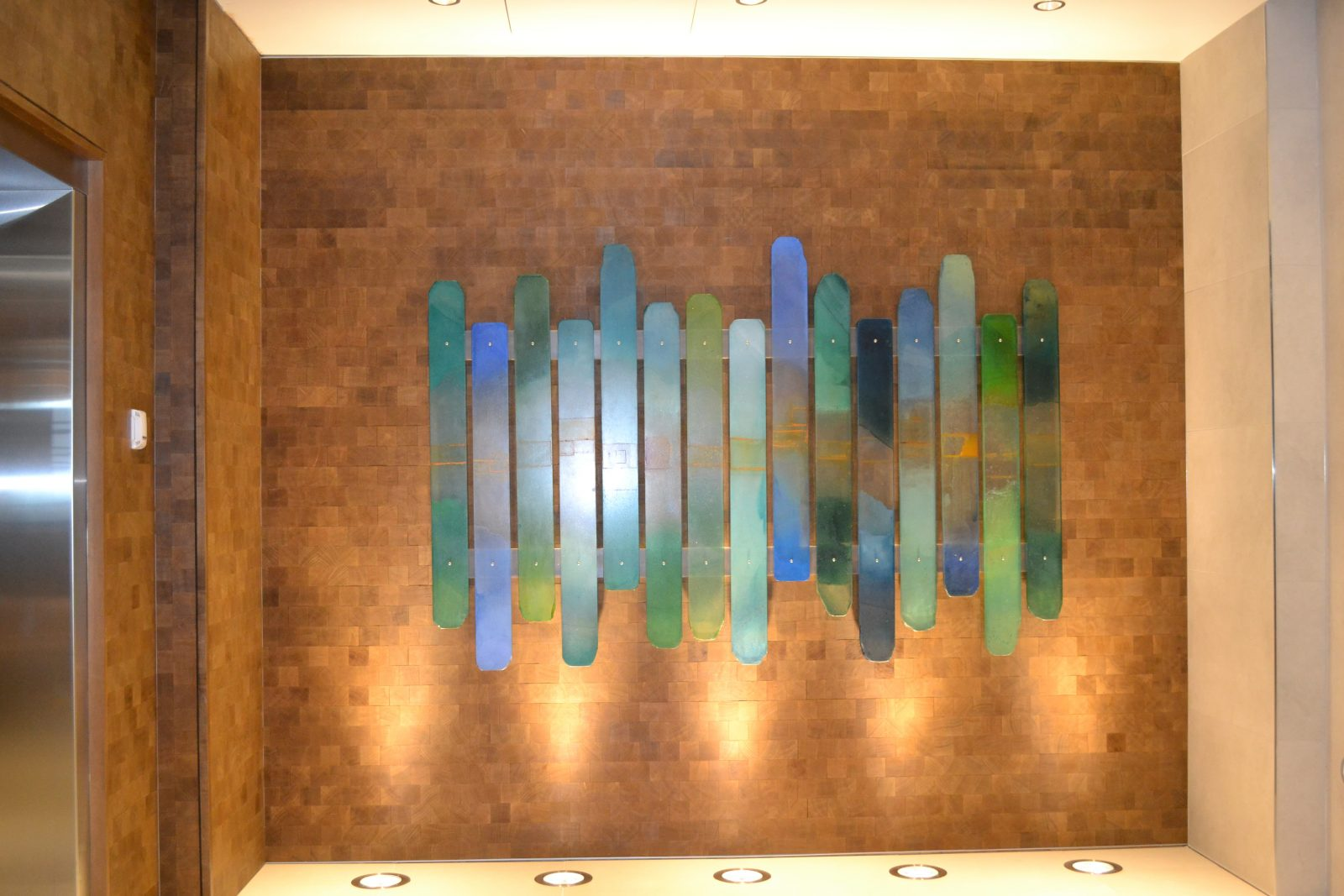 a piece of abstract artwork on the wall of a hotel